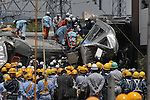 10th Anniversary File Photo: Rescue workers help a victim that was trapped inside a train that crashed into a building in Amagasaki, Japan on April 25, 2005. 107 people were killed in the accident, 562 were injured.<br /> <br /> The accident was Japan's most serious since a train accident in 1963 killed 162 people. (Photo by Duits.co/AFLO)