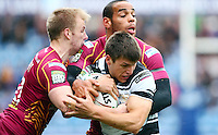 PICTURE BY VAUGHN RIDLEY/SWPIX.COM - Rugby League - Super League - Huddersfield Giants v Hull FC - Galpharm Stadium, Huddersfield, England - 09/04/12 - Huddersfield's Aaron Murphy and Leroy Cudjoe tackle Hull FC's Tom Briscoe.