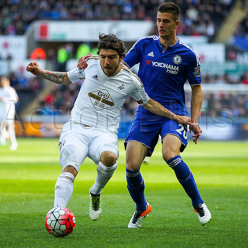 09.04.2016. Liberty Stadium, Swansea, Wales. Barclays Premier League. Swansea versus Chelsea. Swansea City's Alberto Paloschi competes with Chelsea's Matt Miazga for the ball during the match
