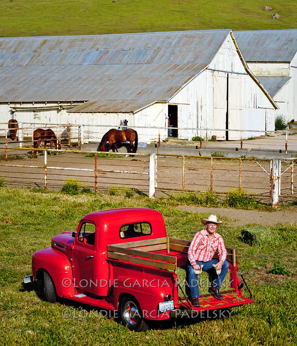 Cowboy on his 1949 Red Ford Truck.  San Luis Obispo, California (John Madonna)