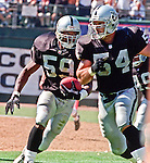 Oakland Raiders vs. Cleveland Browns at Oakland Alameda County Coliseum Sunday, September 24, 2000.  Raiders beat Browns  36-10.  Oakland Raiders linebacker William Thomas (59) recovers ball.