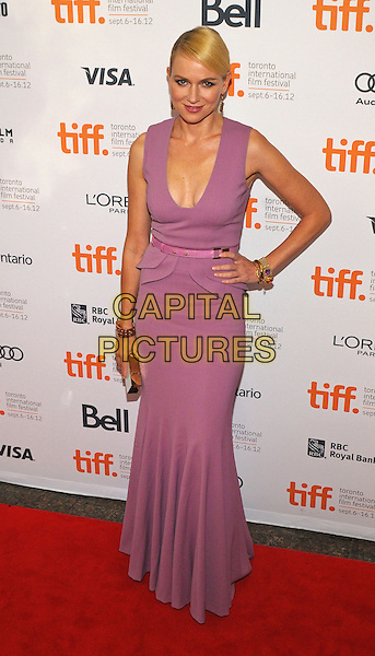 "Naomi Watts.""The Impossible"" Premiere - 2012 Toronto International Film Festival held at Ryerson Theatre, Toronto, Ontario, Canada..September 9th, 2012.TIFF full length pink purple dress low cut neckline cleavage  peplum belt hand on hip.CAP/ADM/BPC.©Brent Perniac/AdMedia/Capital Pictures."