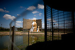 "Statues of ""the world's lagest prairie dogs""  in  Prairie Dog Town, a tourist stop off the interstate north of the Haverfield Ranch.  The ""town"" features a colony of docile prairie dogs, other caged animals, and ""the world's largest prairie dog"" --a 20 foot tall cement statue of a prairie dog.  Stuffed animals in the form of the animals are also available for purchase.  The ""town"" sits near the county seat, the hub of activity that is trying to erradicate prairie dogs from the area...Larry and Bette Haverfield on their ranch near the defunct town of Russell Springs, Kansas.  The Haverfields have been embroiled in a long-running war over the presence of prairie dogs on their ranch.  The Haverfields assert, correctly, that the prairie dogs contribute to increased biodiversity on their property, enabling them to graze their cattle in a fashion that mimics the movement and grazing patterns of pre-settlement buffalo through their range.  The county, particularly county commissioner Carl Ulrich, contend that prairie dogs are a nuisance and should be eradicated.  Many of the haverfields' neighbors feel the same way.  In recent years, the county has exterminated prairie dogs from the Haverfield property using a number of methods, including gas and poison, before sending the Haverfields the bill.  The Haverfields have discovered a number of 'secondary kill' animals, carcasses of birds and mammals that have eaten the poisoned prairie dogs and subsequently been killed themselves.  Complicating matters, the US Fish and Wildlife Service has recently re-introduced endangered black footed ferrets onto the land, a natural predator of the prairie dogs.  This move has heightened tensions between neighbors and led to a series of legal maneuvers on both sides to control the spread of the prairie dogs as well as the ferrets."