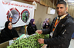 Palestinians attend exhibition for agricultural products in Gaza City on Mar. 22, 2012. to support the Palestinian national products. Photo by Mohammed Asad