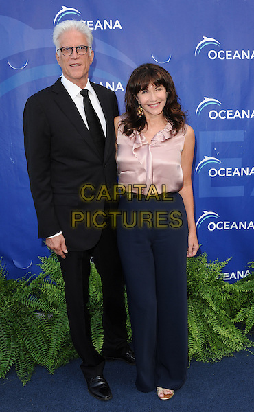 Ted Danson &amp; Mary Steenburgen<br /> 6th Annual Oceana SeaChange Gala held at a Private Villa, Laguna Beach, California, USA.     <br /> August 18th, 2013<br /> full length black suit glasses pink silk satin sleeveless top blouse blue trousers  married husband wife <br /> CAP/DVS<br /> &copy;DVS/Capital Pictures