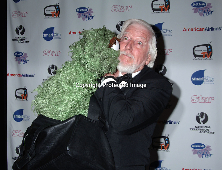 Oscar The Grouch and Carroll Spinney ..arriving to The 33rd Annual Daytime Emmy  Creative Arts Awards on April 22, 2006 at the Marriott Marquis Hotel in New York. ..Robin Platzer, Twin Images