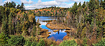 The Colorful Autumn Foliage At Rock Lake Near Ishpeming Michigan In The Upper Peninsula, USA