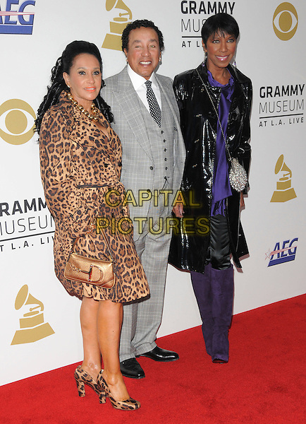 SMOKEY ROBINSON &amp; NATALIE COLE <br /> attends The GRAMMY Nominations Concert Live!! held at Nokia Theatre L.A. Live in Los Angeles, California on December 3rd 2008.<br /> full length black coat patent bag knee high boots dangly earrings purple leopard print coat grey gray suit <br /> CAP/DVS<br /> &copy;Debbie VanStory/Capital Pictures