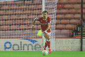 12th September 2017, Oakwell, Barnsley, England; Carabao Cup, second round, Barnsley versus Derby County; Tom Bradshaw of Barnsley FC runs up field to clear his box