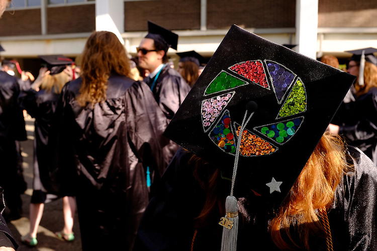 Scripps College and School of Visual Communication graduate Robin Hecker shows off the camera aperture on the top of her mortar board before the start of commencement on Saturday, May 2, 2015.  Photo by Ohio University  /  Rob Hardin