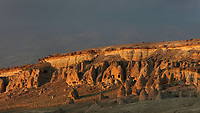 Fairy chimneys and cliffs in the Devrent Valley, known as Imagination Valley, near Goreme in Nevsehir province, Cappadocia, Central Anatolia, Turkey. Homes have been carved out of the rock in the formations along the bottom of the cliff. The rock formations here were made by erosion of the volcanic tuff created by ash from volcanic eruptions millions of years ago, and many resemble figures or animals, such as camels, snakes, seals and dolphins. This area forms part of the Goreme National Park and the Rock Sites of Cappadocia UNESCO World Heritage Site. Picture by Manuel Cohen