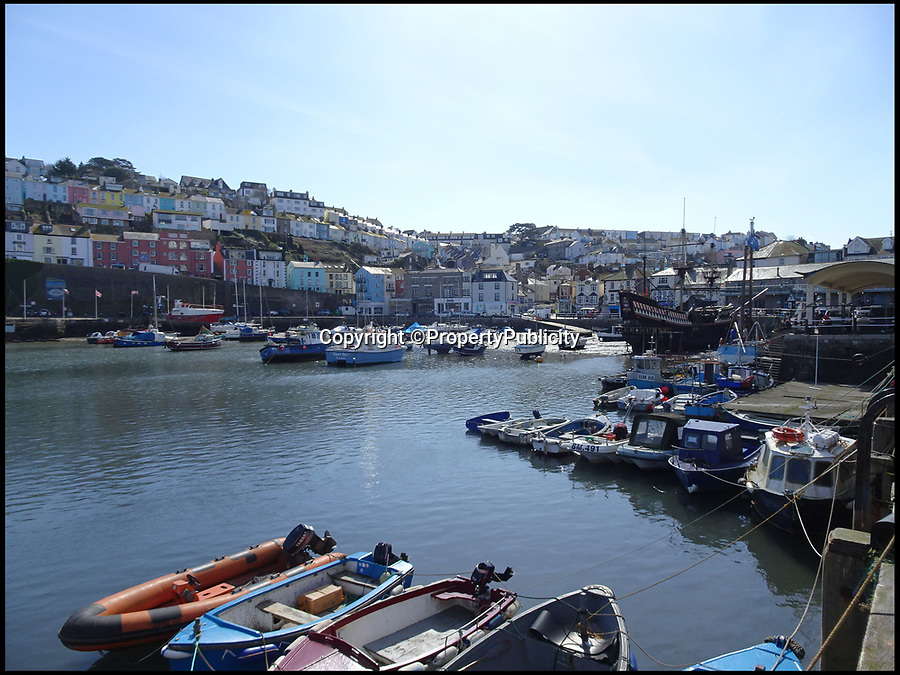 BNPS.co.uk (01202) 558833Pic: PropertyPublicity/BNPS<br /> <br /> Brixham harbour, Devon.<br /> <br /> The 120ft replica of The Golden Hind is up for sale for £195,000...<br /> <br /> A full-size replica of Sir Francis Drake's famed Elizabethan galleon the Golden Hind has emerged for sale for £195,000.<br /> <br /> The 120ft wooden ship is an exact remake of the flagship which Drake sailed round the world from 1577 to 1580, the first Englishman ever to circumnavigate the globe.<br /> <br /> The boat, which was built in 1988, is the second of two replica Golden Hinds which have taken pride of place in Brixham, Devon, since the 1954.<br /> <br /> The current owner, Neil Worrell, 58, bought the boat four years ago with his wife, who has since passed away.<br /> <br /> During their ownership the pair did a lot of renovation to the museum boat, including replacing the crows nests and gangplanks, painting it and generally updating the whole facility.