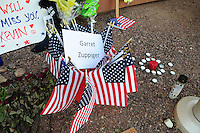Phoenix, Arizona. July 3, 2013. A small makeshift memorial for the 19 Arizona firefighters who died on June 30 battling the Yarnell Hill wildfire was built outside the Forensic Science Center in Phoenix, where autopsies are being conducted. Small American flags fill this container who has the name of one of the firefighters who died in Arizona on Sunday, June 30, 2013. Photo by Eduardo Barraza © 2013