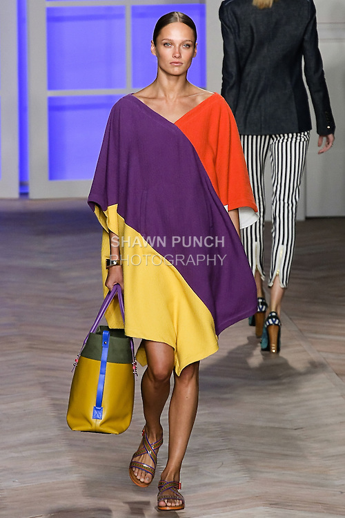 Karmen Pedaru walks the runway in a orange/purple/yellow cotton color black v-neck poncho, and blue/green bikini bottom, by Tommy Hilfiger for the Tommy Hilfiger Spring 2012 Pop Prep Collection, during Mercedes-Benz Fashion Week Spring 2012.