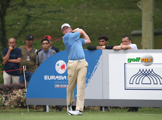 Team Europe's Jamie Donaldson (WAL) drives down the 8th needing some good fortune to claw back 3 strokes during the first day Foursomes at the 2014 Eurasia Cup presented by DRB-Hicom, at the Glenmarie Golf & Country Club, Kuala Lumpur, Malaysia. Picture:  David Lloyd / www.golffile.ie