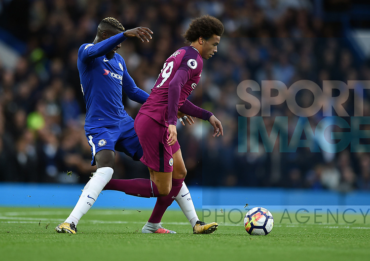 Leroy Sane of Manchester City is challenged by Tiemoue Bakayoko of Chelsea during the premier league match at the Stamford Bridge stadium, London. Picture date 30th September 2017. Picture credit should read: Robin Parker/Sportimage