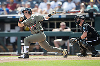 Vanderbilt Commodores outfielder Pat DeMarco (18) follows through on his swing during Game 3 of the NCAA College World Series against the Louisville Cardinals on June 16, 2019 at TD Ameritrade Park in Omaha, Nebraska. Vanderbilt defeated Louisville 3-1. (Andrew Woolley/Four Seam Images)