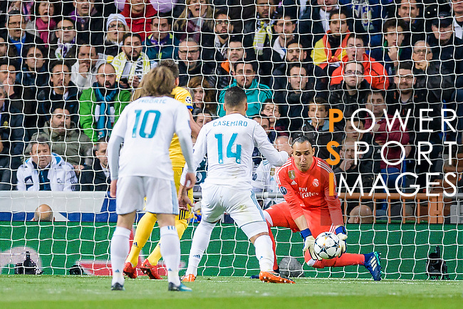Goalkeeper Keylor Navas of Real Madrid (R) reaches for the ball after an attempt at goal by Juventus during the UEFA Champions League 2017-18 quarter-finals (2nd leg) match between Real Madrid and Juventus at Estadio Santiago Bernabeu on 11 April 2018 in Madrid, Spain. Photo by Diego Souto / Power Sport Images