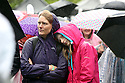 People brave the rain at Belfast Botanic Gardens, where the Big IF Belfast concert is taking place ahead of the G8 Summit in Northern Ireland, Saturday, June 15, 2013. Leaders from Canada, France, Germany, Italy, Japan, Russia, USA and UK are meeting at Lough Erne in Northern Ireland for the G8 Summit 17-18 June. Photo/Paul McErlane