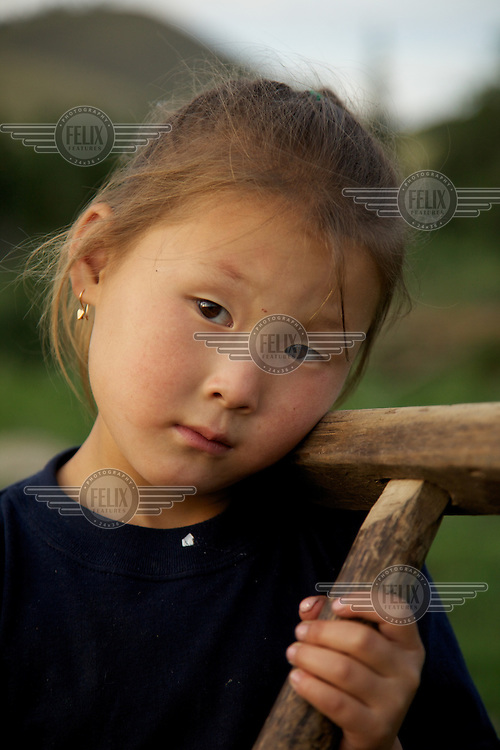 Rima Natpiool, 5, poses for a portrait at home outside Chodura village the taiga in Tuva Republic, Russia