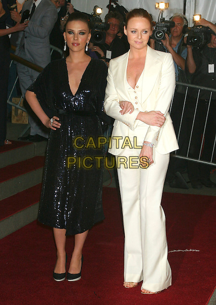 SCARLETT JOHANSSON & STELLA McCARTNEY.Arrivals at The Costume Institute Gala, held at .The Metropolitan Museum of Art, New York - NY, USA,.01 May 2006..full length white cream suit black sparkly dress.Ref: IW.www.capitalpictures.com.sales@capitalpictures.com.©Ian Wilson/Capital Pictures