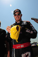 Apr 25, 2009; Talladega, AL, USA; NASCAR Sprint Cup Series driver Brian Vickers signs autographs during qualifying for the Aarons 499 at Talladega Superspeedway. Mandatory Credit: Mark J. Rebilas-
