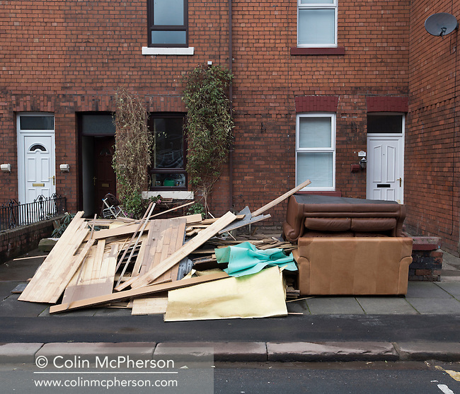 Furniture and other households goods damaged by flooding in Carlisle at the beginning of December, 2015. Record rain fall in Cumbria caused flooding to several areas of Carlisle, causing houses to be evacuated by emergency services.