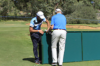 Edoardo Molinari (ITA) helps a marshall move one of the boardings that are in his way on the 1st during Round 1 of the ISPS HANDA Perth International at the Lake Karrinyup Country Club on Thursday 23rd October 2014.<br /> Picture:  Thos Caffrey / www.golffile.ie