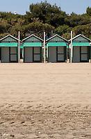 Green beach huts on the lido beach, Venice lagoon, Italy. May 2007.