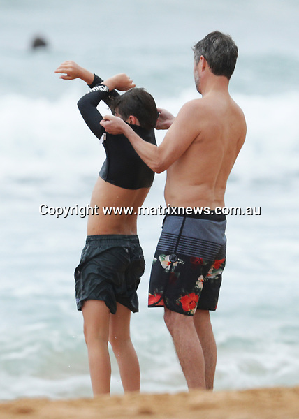 21 DECEMBER 2017 SYDNEY AUSTRALIA<br /> WWW.MATRIXNEWS.COM.AU<br /> <br /> EXCLUSIVE PICTURES<br /> <br /> Crown Prince Frederik of Denmark pictured having a swim at Palm Beach with the kids on a gloomy Thursday morning.