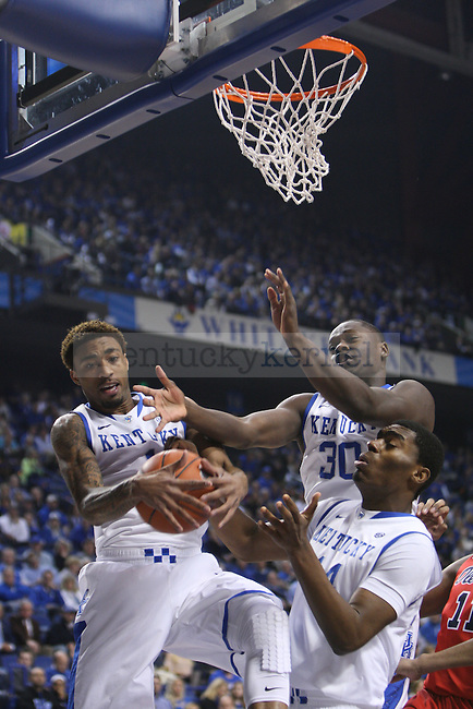 UK guard/forward James Young (1), forward Julius Randle (30), and center Dakari Johnson (44) reach for a rebound during the first half of UK Men's Basketball vs. Ole Miss at Rupp Arena in Lexington, Ky., on Tuesday, February 4, 2014. Photo by Emily Wuetcher | Staff