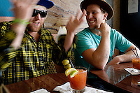 Venice, California, December 8, 2008 - Brothers and long board surfers Trace (L) and Chad Marshall drinking bloody marys at Danny's Venice Deli.  The brothers along with Rick Klotz created the clothing line, Warriors of Radness.