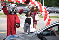Springdale High School sophomore cheerleaders Allyssa Villegas (from left), Tania Mancia and Allysha Garnett cheer on seniors as they pass Monday, May 18, 2020, during the Springdale High School Bulldog Bash at the High School. Seniors were given the opportunity to drop off school materials, pick up signs and receive cords and awards. The event kicked off the 12 Days of Graduation event. Check out nwaonline.com/200519Daily/ and nwadg.com/photos for a photo gallery.<br /> (NWA Democrat-Gazette/David Gottschalk)