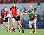 Gary Brennan of Clondegad in action against Michael Hogan and Martin Mc Mahon of Kilmurry Ibrickane during their senior county final at Cusack park. Photograph by John Kelly.