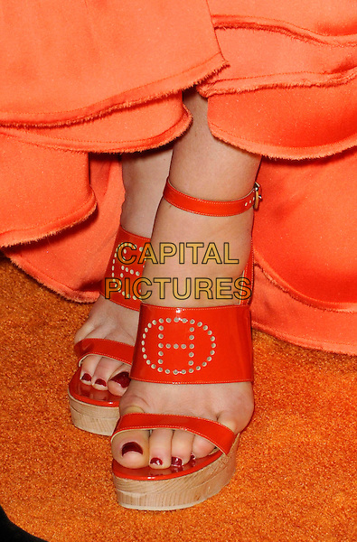 DEE OCLEPPO's shoes.The 17th Annual Race to Erase MS at the Hyatt Regency Century Plaza Hotel in Century City, California, USA..May 7th, 2010.feet heels holes punctured tommy hilfiger platform sandals open toe red nail varnish polish red orange .CAP/ROT.©Lee Roth/Capital Pictures
