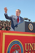 United States President George W. Bush waves to more than 20,000 Marines, sailors and family members after an address at the W.P.T. Hill Field here April 3, 2003.   The President visited the base to thank service members for their dedication and military families for their sacrifices while separated from spouses deployed in support of Operation Iraqi Freedom.  He also expressed his sympathy and concern for families who have lost loved ones in the war. <br /> Mandatory Credit: Donald E. Preston / DoD via CNP