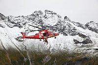 "Switzerland. Canton Ticino. Chironico valley. A Rega Agusta AW109 SP Grand ""Da Vinci"" helicopter has rescued a swiss german hiker with an injured ankle. By using a rescue hoist, a helicopter can rescue persons from hard-to-reach areas in the Alps. The Vertical Rescue Triangular Harness secures the emergency physician, Doctor Michele Musiari, and the patient during a lift. The Vertical Rescue Triangular Harness is a simple yet robust patient lifting sling designed for all forms of rapid vertical extrications. The simple design allows the harness to be applied to the patient easily and quickly compared to other full body rescue harnesses. All Rega helicopters carry a crew of three: a pilot (Corrado Sasselli), an emergency physician, and a paramedic (Paolo Menghetti) who is also trained to assist the pilot for radio communication, navigation, terrain/object avoidance, and winch operations. The name Rega was created by combining letters from the name ""Swiss Air Rescue Guard"" as it was written in German (Schweizerische Rettungsflugwacht), French (Garde Aérienne Suisse de Sauvetage), and Italian (Guardia Aerea Svizzera di Soccorso). Rega is a private, non-profit air rescue service that provides emergency medical assistance in Switzerland. Rega mainly assists with mountain rescues, though it will also operate in other terrains when needed, most notably during life-threatening emergencies. As a non-profit foundation, Rega does not receive financial assistance from any government. People in distress can call for a helicopter rescue directly (phone number 1414). The AgustaWestland AW109 is a lightweight, twin-engine, helicopter built by the Italian manufacturer Leonardo S.p.A. (formerly AgustaWestland, Leonardo-Finmeccanica and Finmeccanica). Leonardo S.p.A is an Italian global high-tech company and one of the key players in aerospace. In close collaboration with the manufacturer, the Da Vinci has been specially designed to cater for Rega's particular requirements as regards"