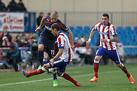 Atletico de Madrid´s Mandzukic and Mario Suarez and Olympiacos´s Kasami during Champions League soccer match between Atletico de Madrid and Olympiacos at Vicente Calderon stadium in Madrid, Spain. November 26, 2014. (ALTERPHOTOS/Victor Blanco) /NortePhoto