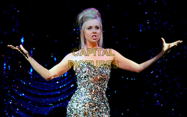 DIANA VICKERS.Performs on stage during the photocall for 'Little Voice', London, England. .October 19th, 2009.acting half length singing strapless dress hands arms outstretched silver sequins sequined .CAP/CJ.©Chris Joseph/Capital Pictures.