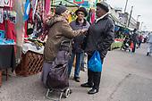 Women talking in Ridley Road market, Dalston, Hackney, London