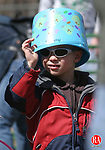 OXFORD, CT 5/31/07- 03107BZ03- Nicholas Macisco, 3, of Oxford, uses his bucket as a hat before the start of  an Easter Egg hunt in Oxford Saturday afternoon.<br /> Jamison C. Bazinet Republican-American
