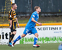 Queen of the South's Gavin Reilly celebrates after he scores their third goal.
