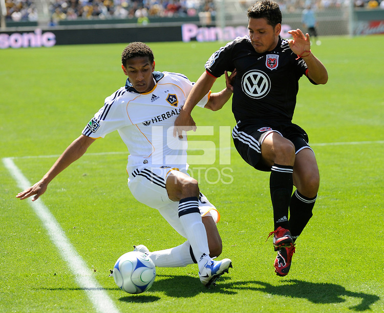 D.C. United's Christian Gomez (right) and Los Angeles Galaxy's Sean Franklin (left) battle for the ball at the Home Depot Center in Carson, CA  on Sunday, March 22, 2009.