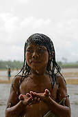 Pará State, Brazil. Aldeia Apyterewa (Parakana). Girl enjoying the rain.