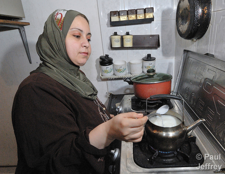 A woman prepares tea in her apartment in the Beach Refugee Camp in Gaza.