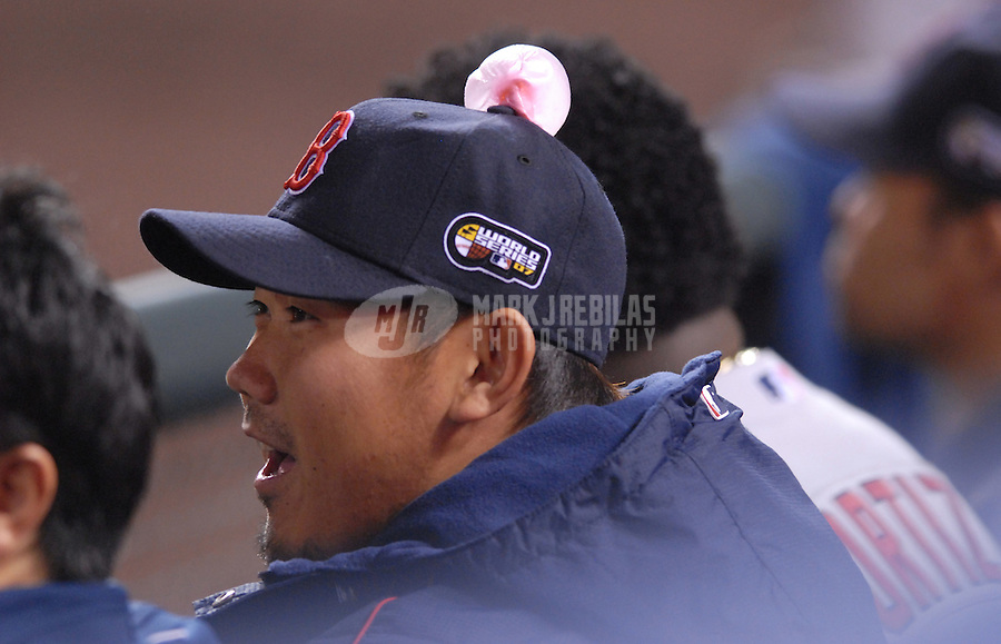 Oct 28, 2007; Denver, CO, USA; Boston Red Sox pitcher Daisuke Matsuzaka sits in the dugout unaware of the gum on his head against the Colorado Rockies during game 4 of the 2007 World Series at Coors Field. Mandatory Credit: Mark J. Rebilas-US PRESSWIRE