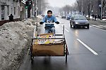 "THIS PHOTO IS AVAILABLE AS A PRINT OR FOR PERSONAL USE. CLICK ON ""ADD TO CART"" TO SEE PRICING OPTIONS.   Admir Obilit, a Roma man, collects cardboard and other recyclable material in his peddle-driven cart in Belgrade, Serbia. Many Roma came to Belgrade as refugees from Kosovo. Lacking legal status in Serbia, many have difficulty obtaining formal employment and accessing government services. Recycling is a common means for Roma to earn income."