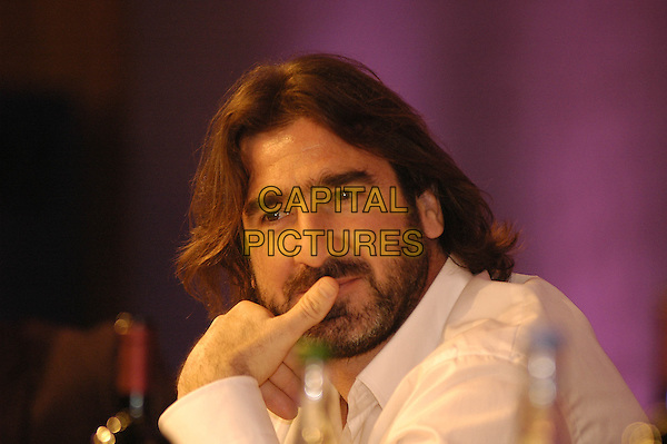 ERIC CANTONA.10th Annual HMV Football Extravaganza 2005 Charity Dinner, raising money for Nordoff-Robbins Music Thearapy, Grosvenor House, Park Lane, London, .March 29th 2005..portrait headshot beard facial long hair finger hand over mouth.** EXCLUSIVE **.www.capitalpictures.com.sales@capitalpictures.com.©Hugh Thompson/Capital Pictures