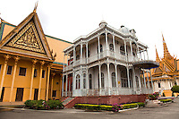 The Royal Palace in Phnom Penh was constructed over a century ago to serve as the residence of the King of Cambodia, his family and as a venue for the performance of court ceremony and ritual and as a symbol of the Kingdom. It serves to this day as the Cambodian home of King Norodom Sihamoni and former King Norodom Sihanouk. The Royal Palace complex and attached Silver Pagoda compound consist of several buildings, structures and gardens all located in walled grounds overlooking a riverfront park.