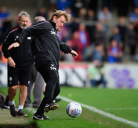 Scunthorpe United manager Stuart McCall attempts to control the ball<br /> <br /> Photographer Chris Vaughan/CameraSport<br /> <br /> The EFL Sky Bet League One - Scunthorpe United v Peterborough United - Saturday 13th October 2018 - Glanford Park - Scunthorpe<br /> <br /> World Copyright &copy; 2018 CameraSport. All rights reserved. 43 Linden Ave. Countesthorpe. Leicester. England. LE8 5PG - Tel: +44 (0) 116 277 4147 - admin@camerasport.com - www.camerasport.com